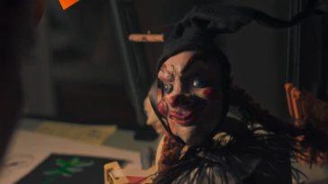 A creepy doll on a table