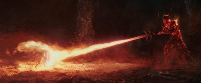 Thor blocking Surtur's fire with his hammer