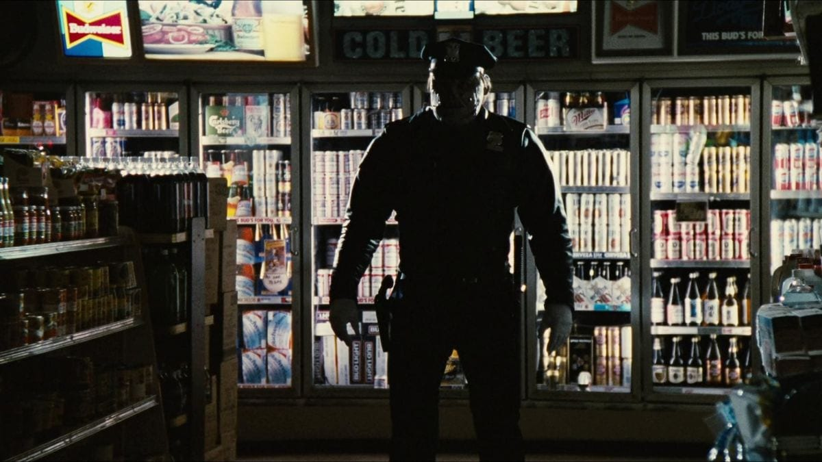 Matt Cordell in silhouette in front of the coolers in a convenience store