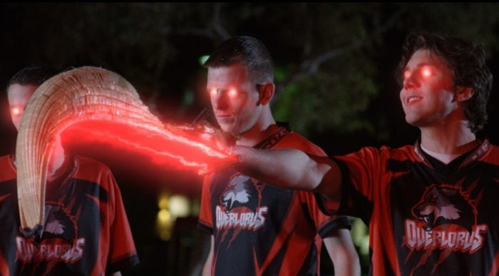 Seth (Lukas Gage) and friends possessed by a demon from a video game in Max Reload and the Nether Blasters