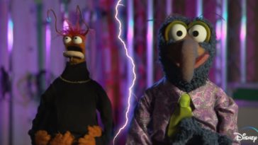 "Pepé the King Prawn looks up in awe at spontaneous lightning while standing next to Gonzo the Great, who's announcing the premiere of, ""Muppets Haunted Mansion"" on Disney+."