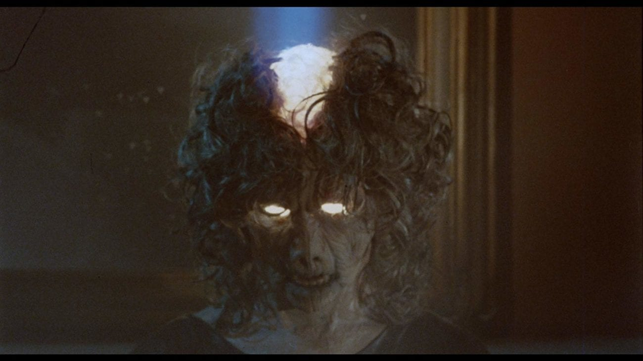 Female villain with eyes and top of head filled with light