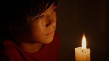 Dylan holding a candle