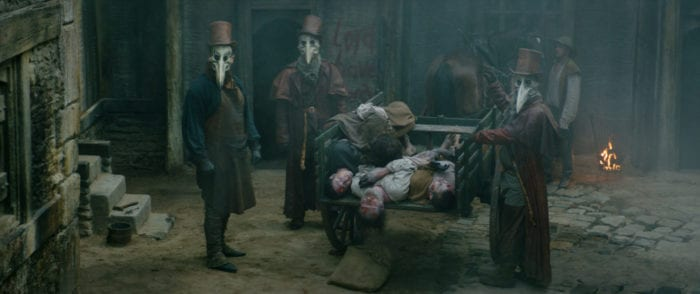 The plague doctors collect the dead.