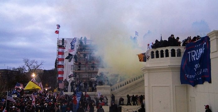 tear gas billows from the stairs of the Capitol building