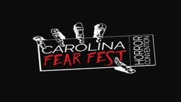 "An illustration of a skeleton hand holding a card that reads ""CAROLINA FEAR FEST"" in the center, and ""HORROR CONVENTION) vertically on the right side. Everything is white on a black background, except for the text ""FEAR FEST"", which is red."