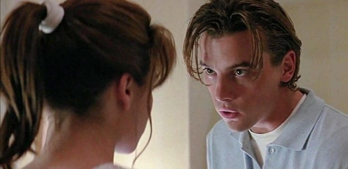 The characters Sidney and Billy from Scream are seen having a conversation.