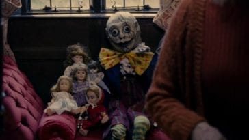 The Humpty Dumpty doll sitting with other dolls