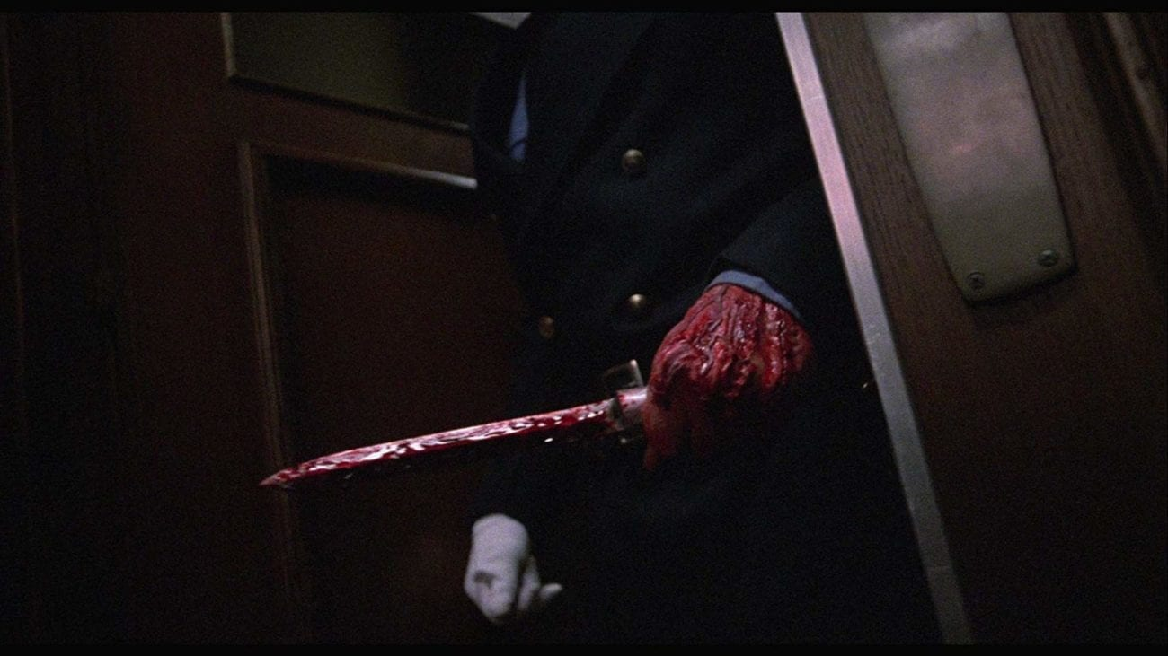 Matt Cordell's bloody hand holding a bloody knife