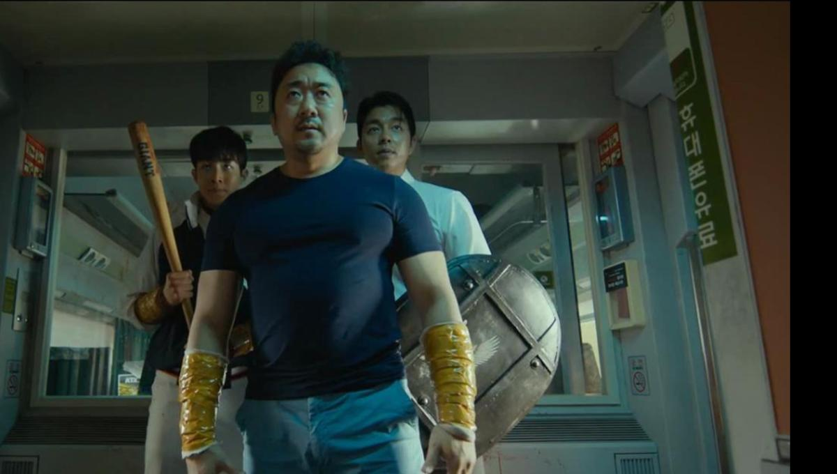 The 3 male leads preparing to fight the zombies
