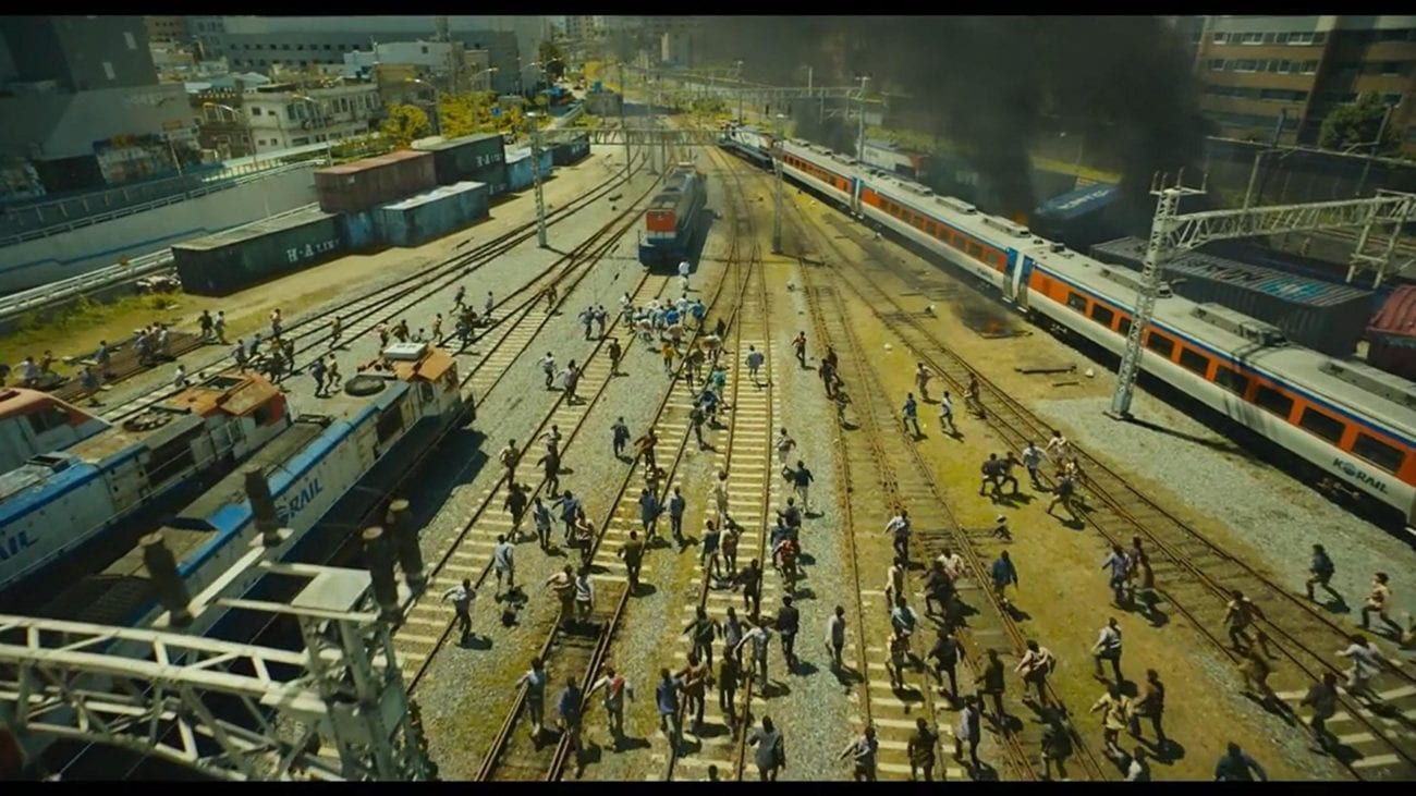 Overhead shot of zombies chasing the train in a trainyard