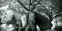 Statue of Edgar Allan Poe with a large raven