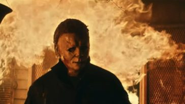 Michael Myers walks out of a fire engulfed house.