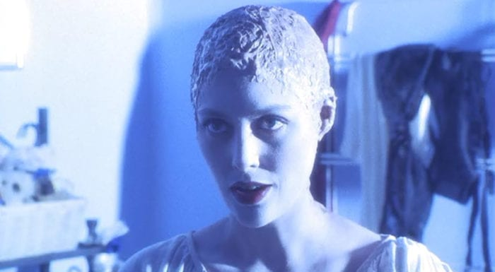 Candyman's Helen Lyle (Virginia Madsen) appears to murder her cheating husband Trevor in the film's ending