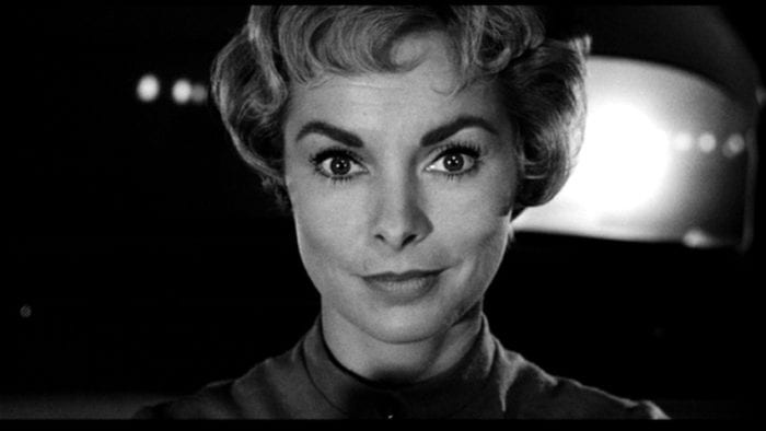 Marion Crane from Psycho with a sly expression on her face.