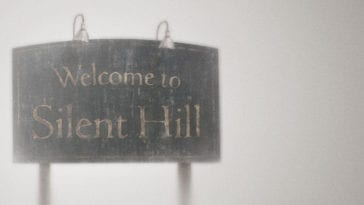 The Silent Hill sign surrounded by fog and mist.