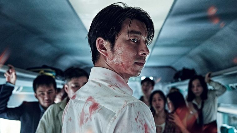 Seok-woo looking back with blood all over him