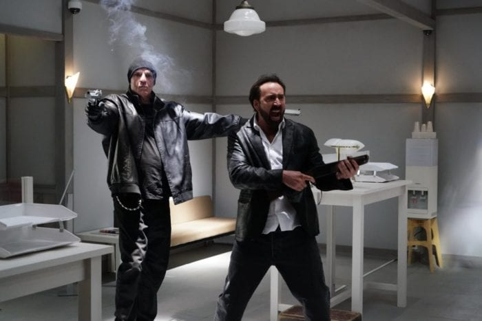 Nicolas Cage as Hero and Nick Cassavetes as Psycho, poised to shoot, in Prisoners of the Ghostland
