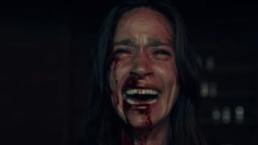 Elisa screams as blood protrudes from her nose and right eye