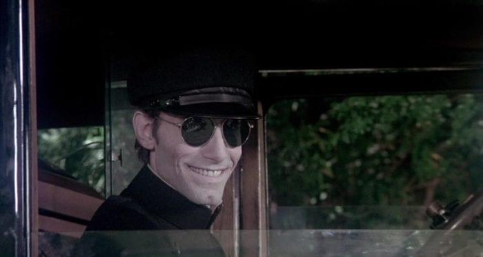 Driver smiles creepily.