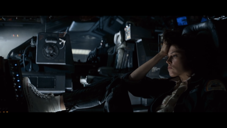 Ripley contemplates her situation in the cockpit
