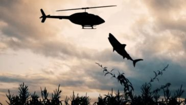 Shark attacking a helicopter in a corn field.