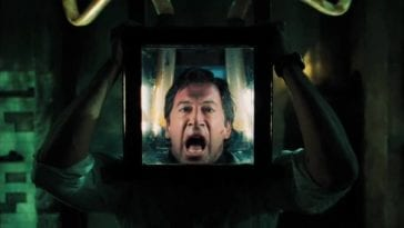 Peter Strahm (Scott Patterson) with his head inside a box in a Saw trap