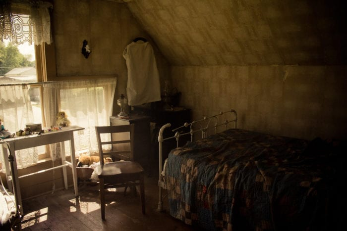 Interior of a child's bedroom in the Villisca Ax Murder house, decorated to the historical period of the time of the murders.