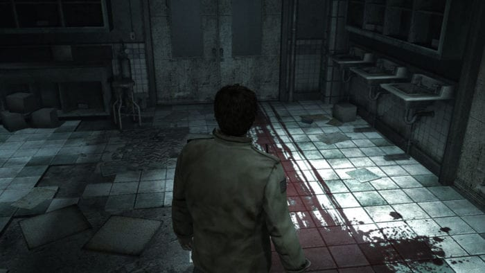 Alex looks at a blood trail that goes into another room in a run down bathroom