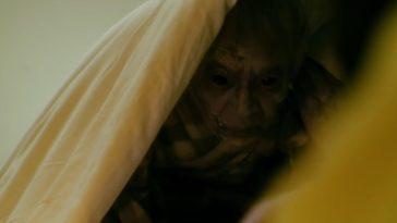 A creepy guy under a bedsheet