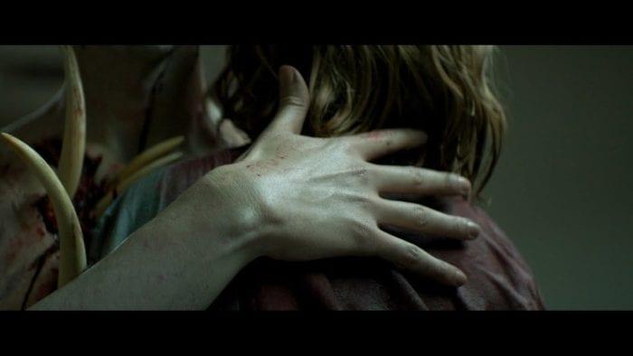 A demon caresses David's (Luke David Blumm) head in the hospital