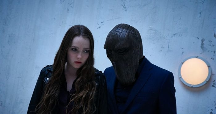 Margot (Amy Forsyth) is confronted by the Masked Magician, who whispers something in her ear that her dad used to say to her