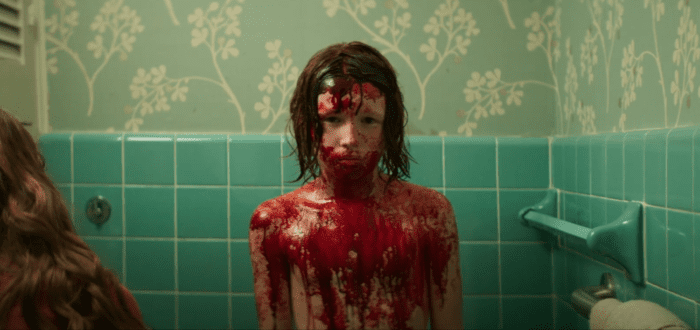David (Luke David Blumm) is covered in blood, stemming from an unsavory event, only to be cared for after by his mom Laura (Andi Matichak)