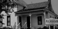 black and white image of the Villisca Ax Murder House with sign out front.