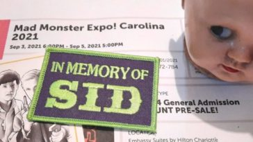 """Image of a Mad Monster Expo ticket with a creepy baby doll head, a card with """"Fright Night's"""" Peter Vincent and Charlie Brewster, and a patch memorializing Sid Haig."""