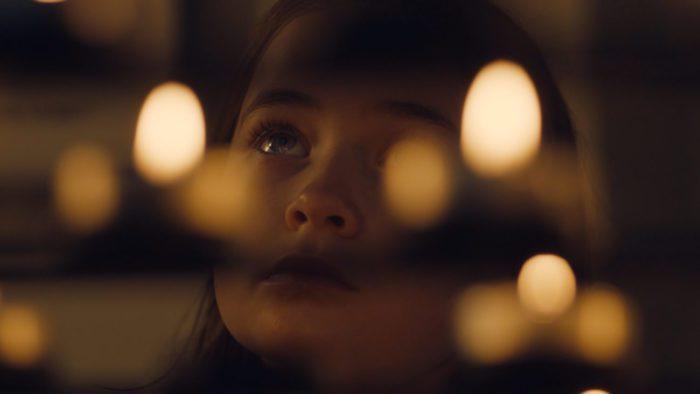 Leah's face seen through lights