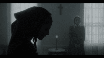Mary contemplating her contrition with her maid Eleanor standing to the side