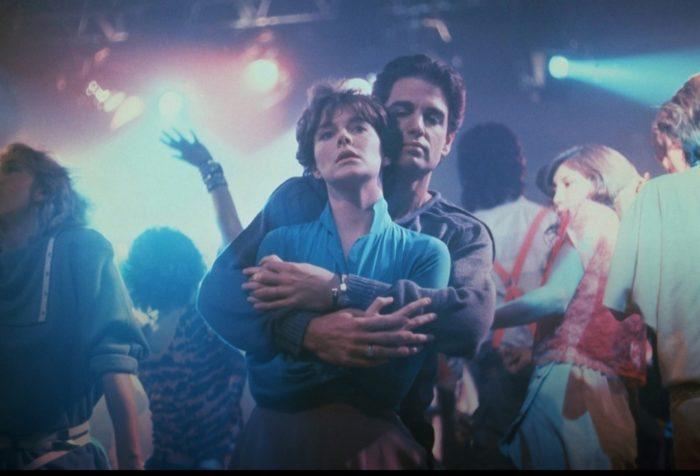 Chris Sarandon's Jerry seduces Amanda Bierce's Amy in a dance club.