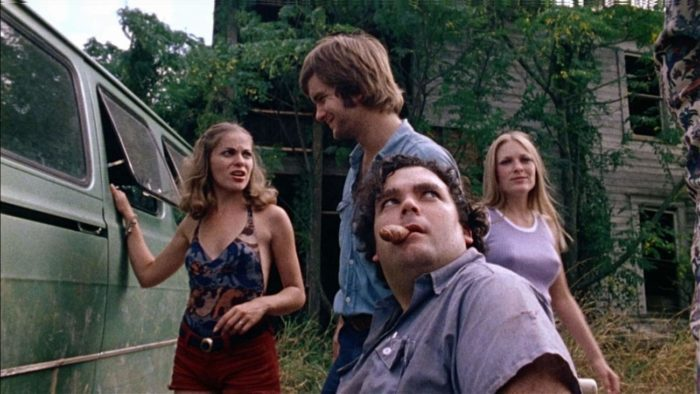 The main cast of The Texas Chainsaw Massacre gather outside of Franklin's and Sally's old family house.