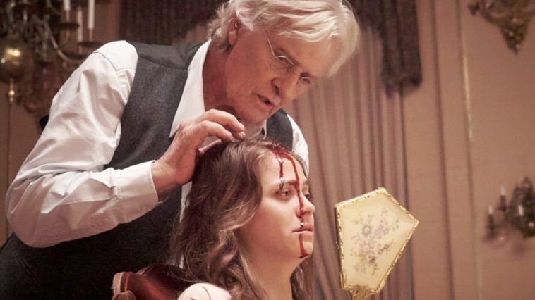 Joseph Peach (Rutger Hauer) performs an operation on Alice to rid her of schizophrenia