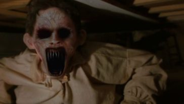 A ghoul with black eye sockets, purple veins, and razor sharp teeth peers out from beneath a bed in Dead Birds.