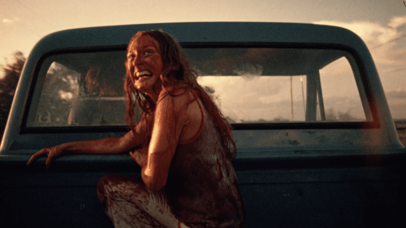 The final girl (Sally Hadesty) looks on in triumph as she escapes from the clutches of the Sawyer Family.