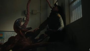 Carnage choking a guy with his symbiote appendages
