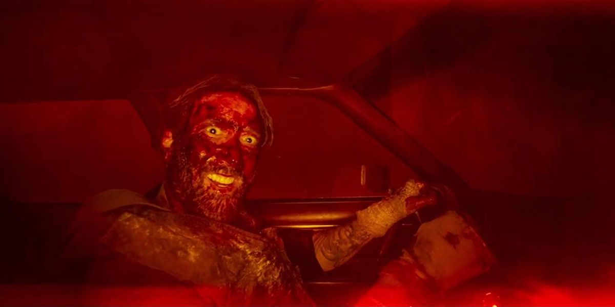 Red driving a car, covered in blood and other unknown...stuff