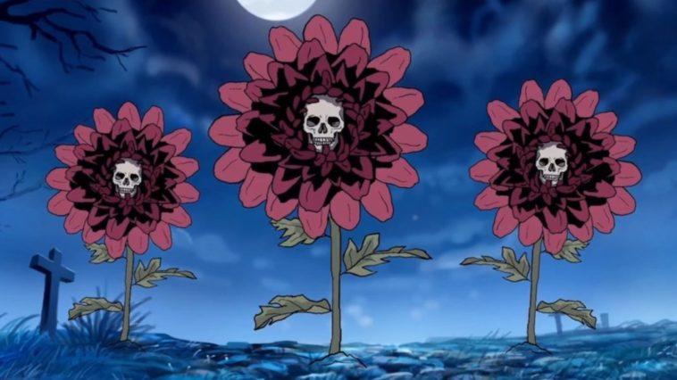 A trio of mums bloom under a graveyard's moonlit sky