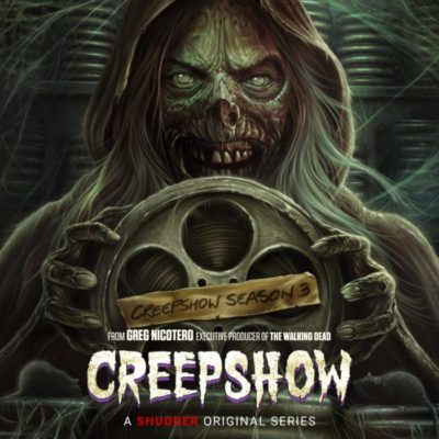 """The """"Creepshow"""" mascot- A decaying mummy corpse grins with receding skin over a reel of film announcing """"Creepshow,"""" season 3. season 3."""