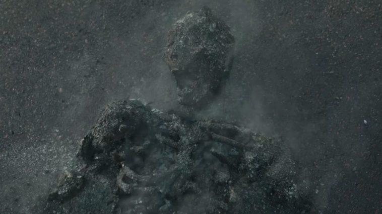 smoldering skeleton in pavement