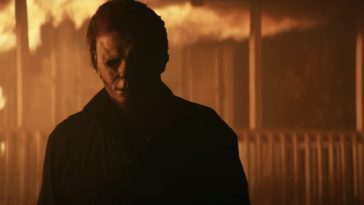 Michael Myers walks away from a burning house