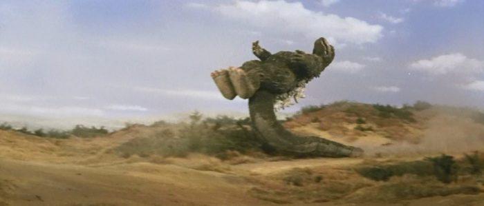 Godzilla doing a dropkick
