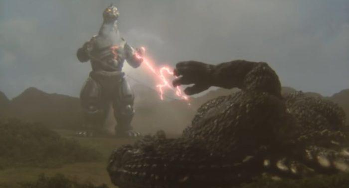 Godzilla sending electrical currents back to Mechagodzilla